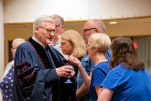 Retired Pastor Rev. J. Keith Cook assists with communion