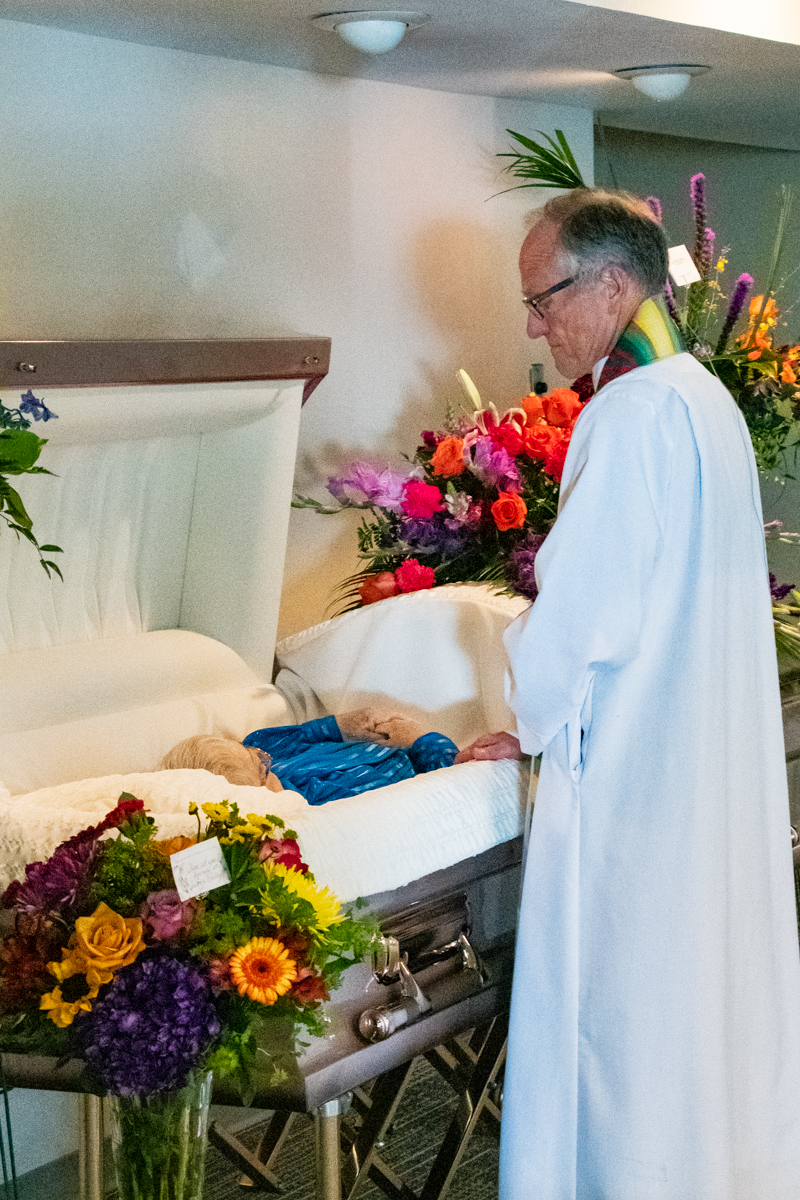 September 4, 2019:  Pastor Bob Keefer pauses for a moment of silent prayer and reflection before officiating the funeral for Nancy Perry.