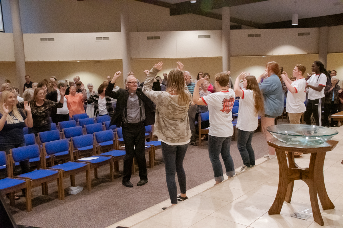 September 29, 2019: Members of the group that attended the 2019 Youth Triennium lead the congregation in a Worship energizer.