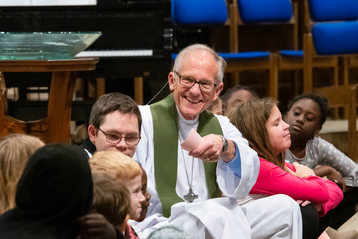 October 13, 2019:  Smiling at the response to his question, Pastor Bob Keefer shares with the young disciples during the Children's message