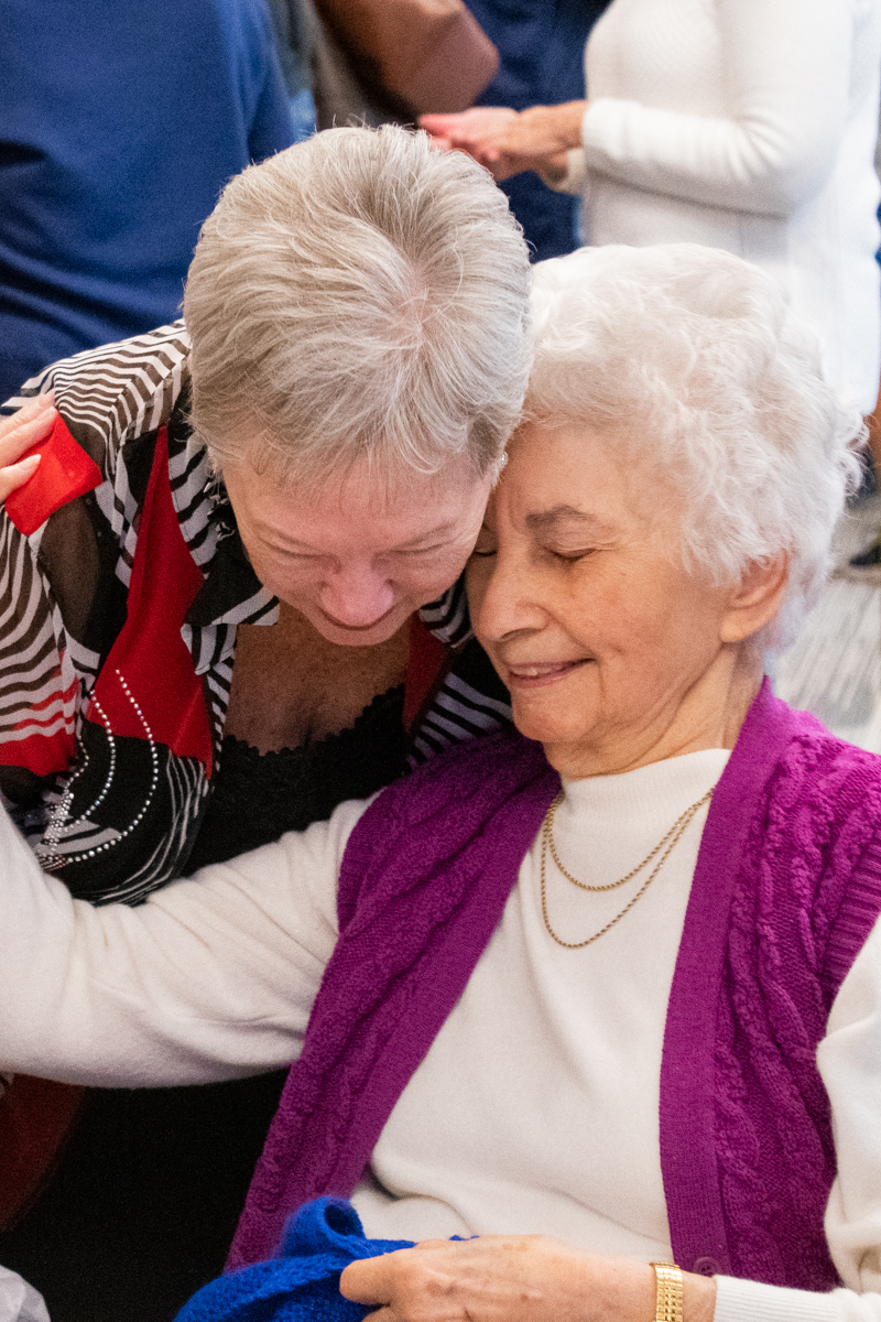 October 27, 2019:  Grace Simard receives a gift for her 100th birthday from the Deacons' Prayer Shawl ministry.
