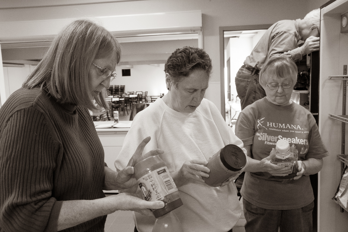"November 2, 2019:  During kitchen clean-up day, Karen Churchill, Ruth McGavren, and Mary McLean play ""which bottle has the oldest expiration date?"""