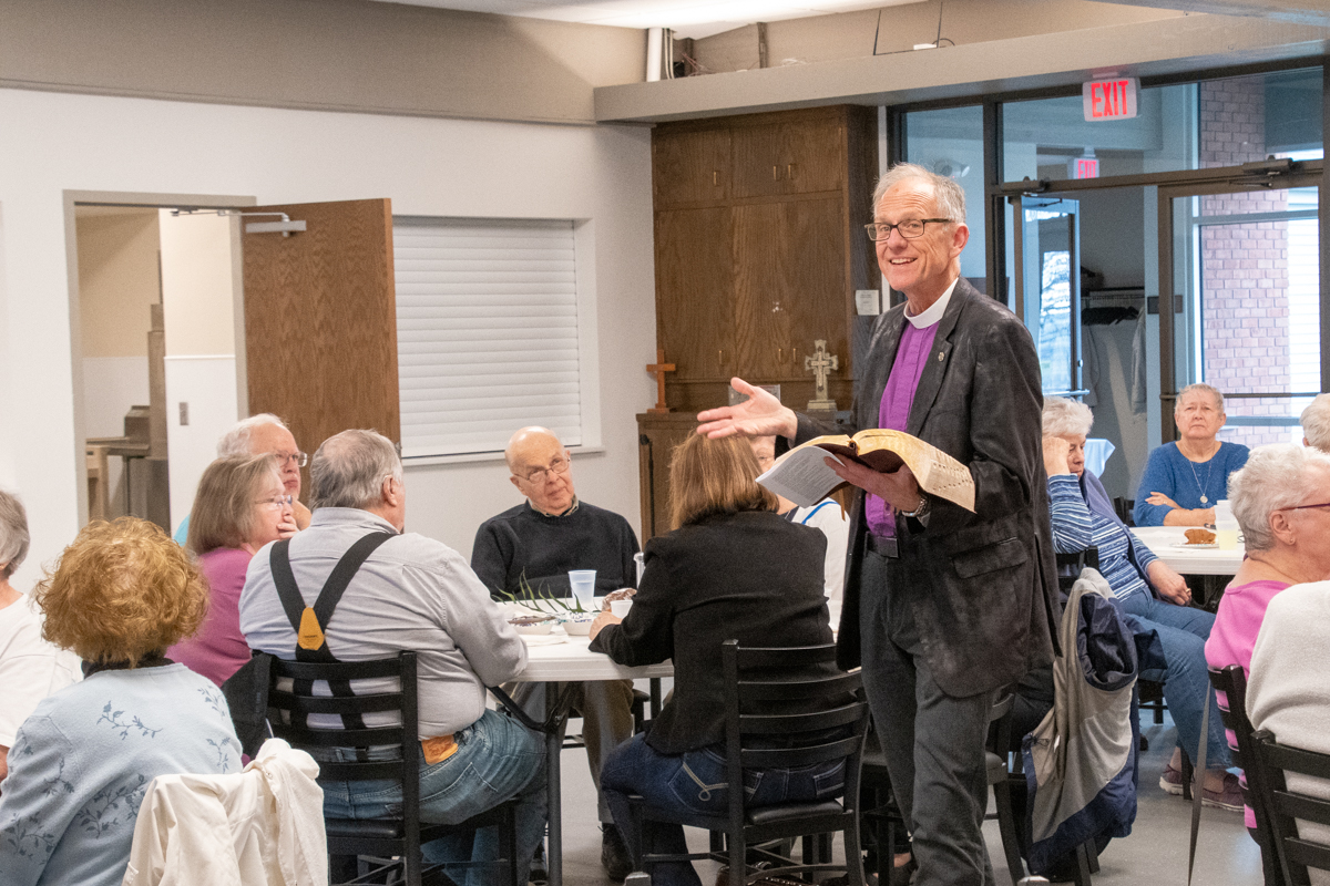 April 18, 2019:  After the Maundy Thursday meal, the Word of God is proclaimed as members prepare for Easter weekend.