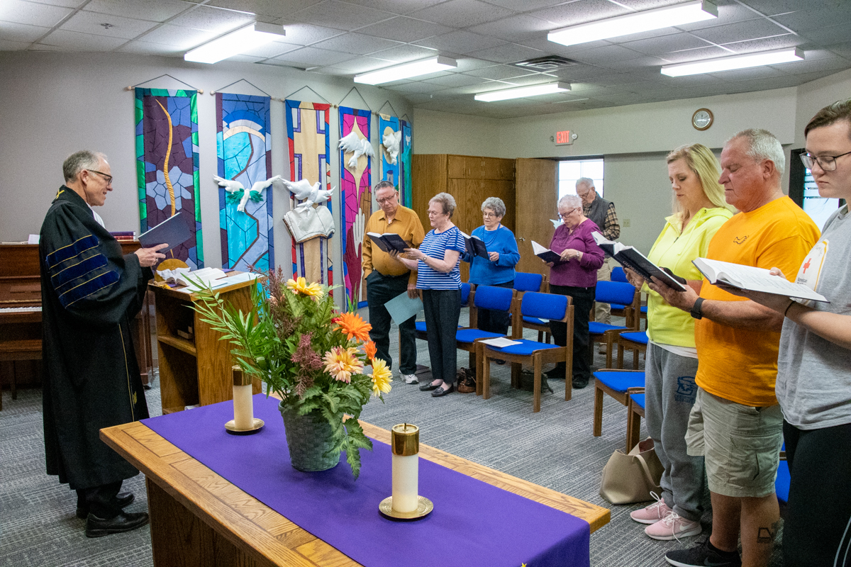 April 19, 2019:  Gathered in Church of the Master's Chapel, the mid-day Good Friday service attendees join together in song.
