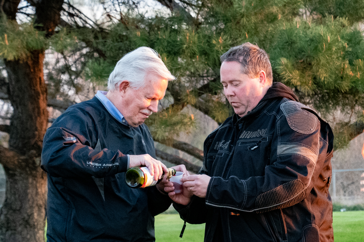 April 21, 2019:  Sometimes serving Communion straight from the bottle is more practical when you are out on the lawn for sunrise Easter service.