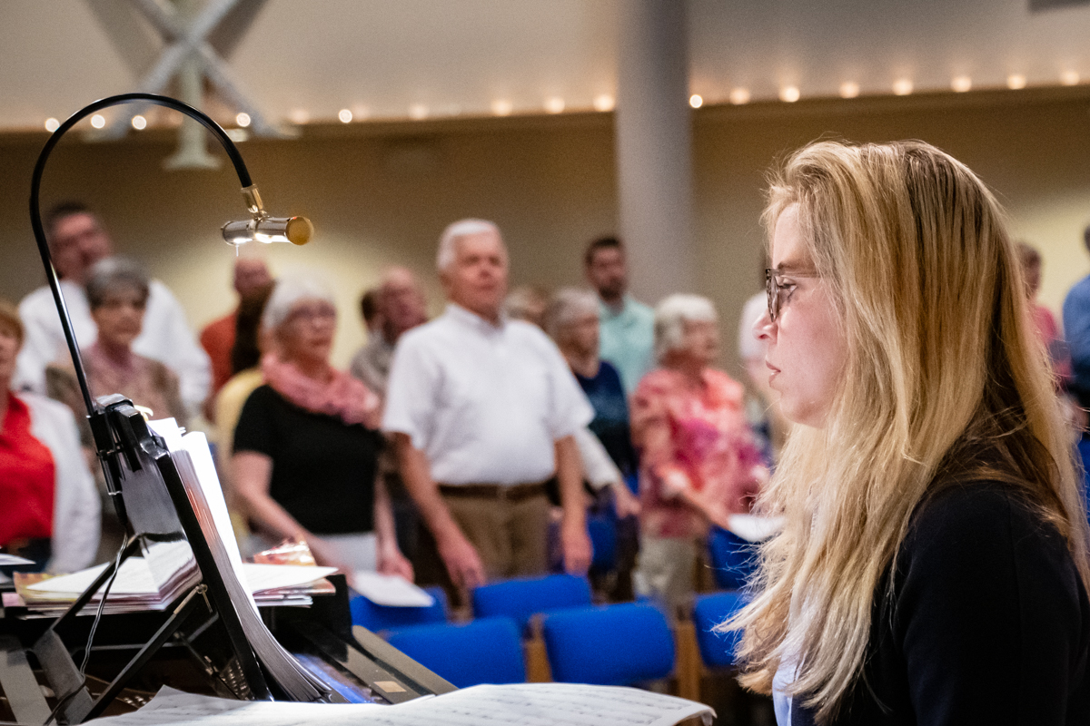 April 21, 2019:  Accompanist Katherine Turner plays as the congregation stands to sing at the 8:15 a.m. Easter Worship service.