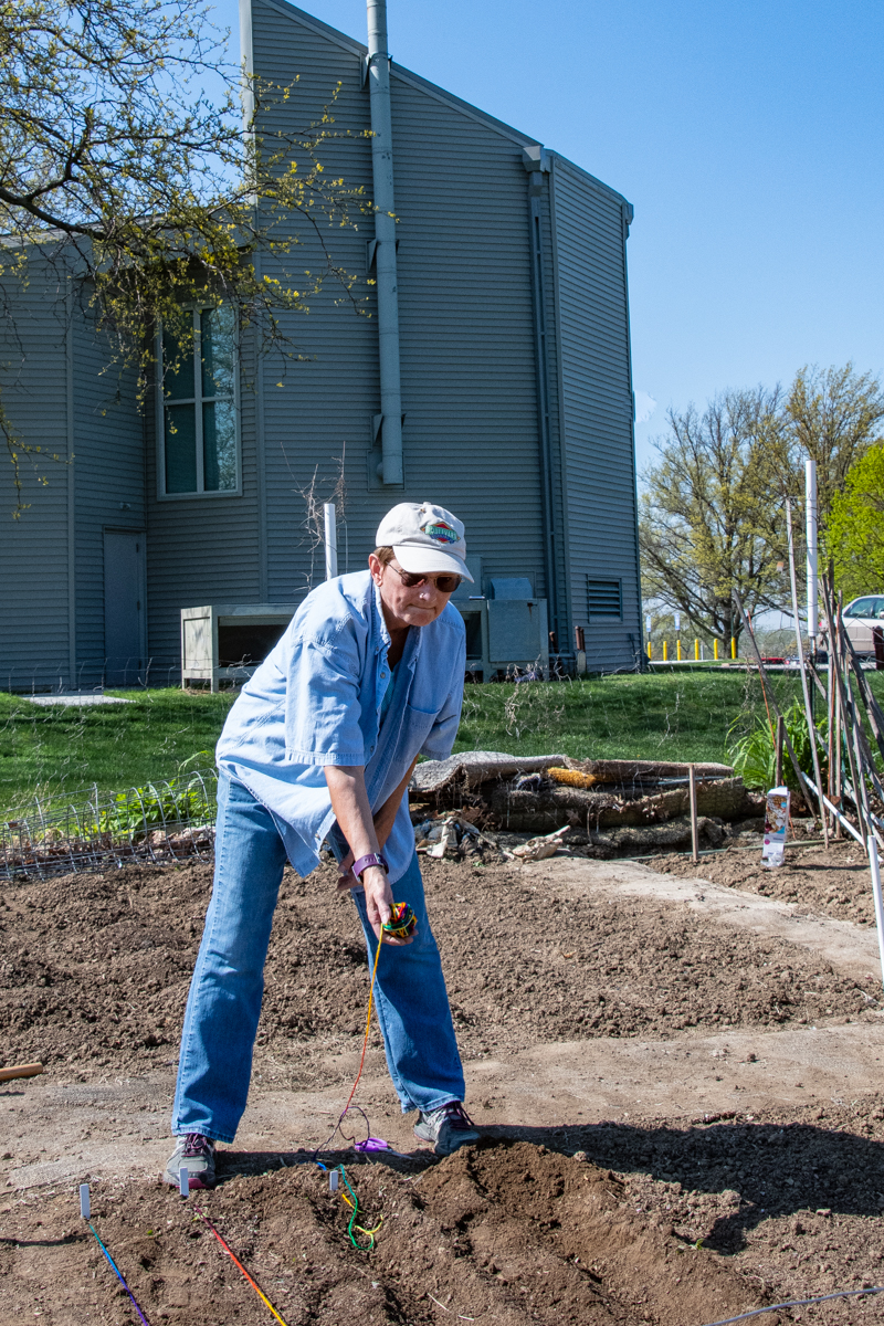 May 4, 2019:  Marcia Risling begins her planting in the Church's community garden which is utilized by both with members and non-members.