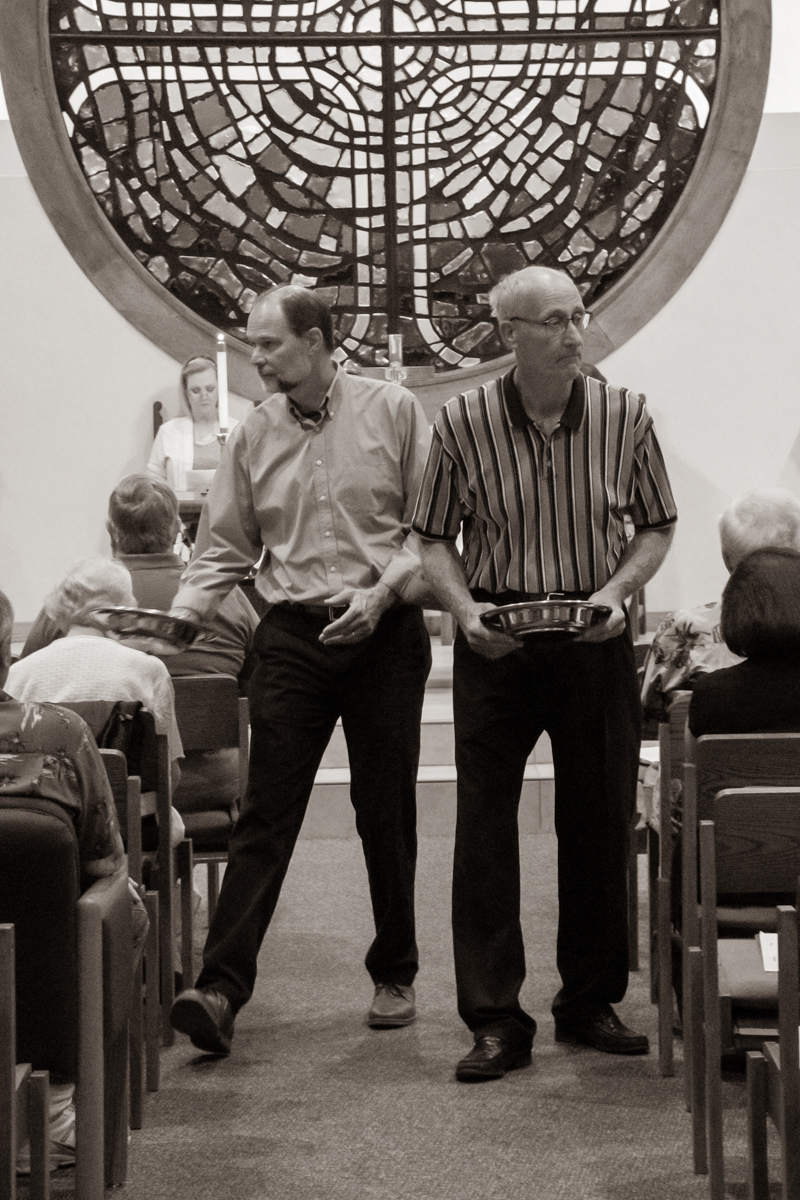 June 23, 2019:  Dylan Johnson and Tim Lambert assist Sunday service as ushers collecting the offering.
