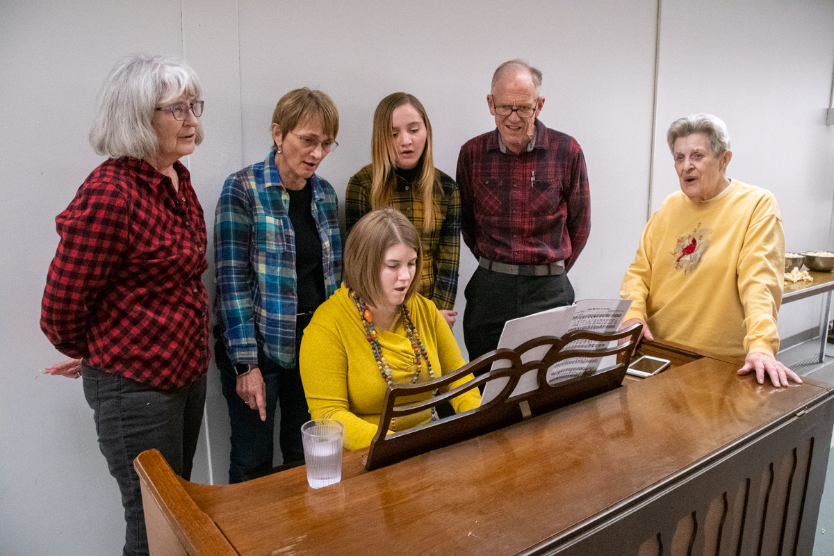 "December 8, 2018:  Some good old fashioned singing of Christmas Carols filled the evening at the Christmas ""Family, Faith and Flannel"" event."