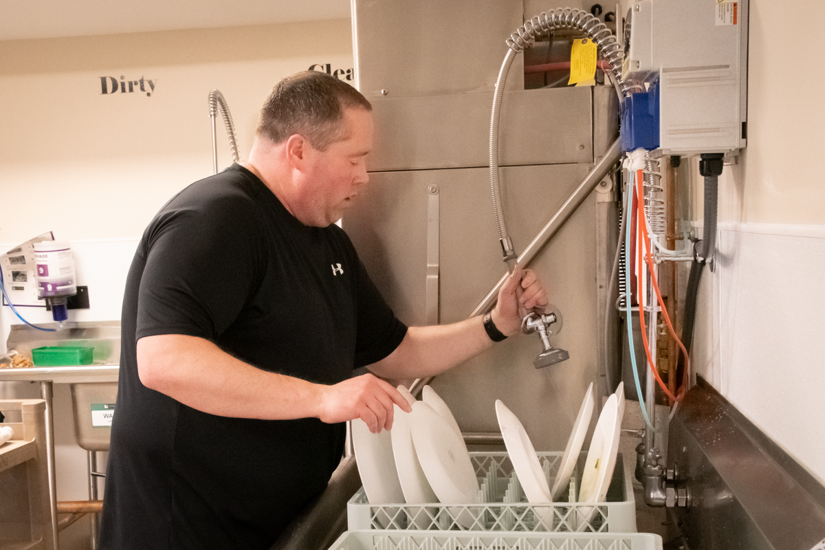 January 27, 2019:  The Annual meeting included lunch which means clean-up.  Andy Zidon runs the dishwasher.