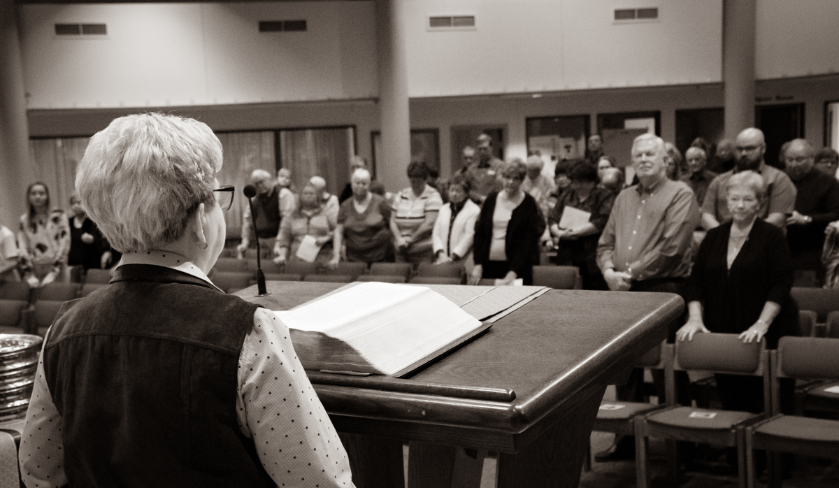 February 3, 2019:  Standing before the congregation, member Shirley Soss shares an announcement during the Worship service.