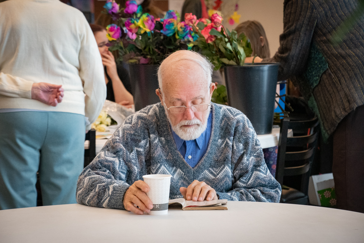 February 10, 2019:  Amid the distraction in the Commons with people all around, Jerry Ludwig can manage to read his book and enjoy his coffee.