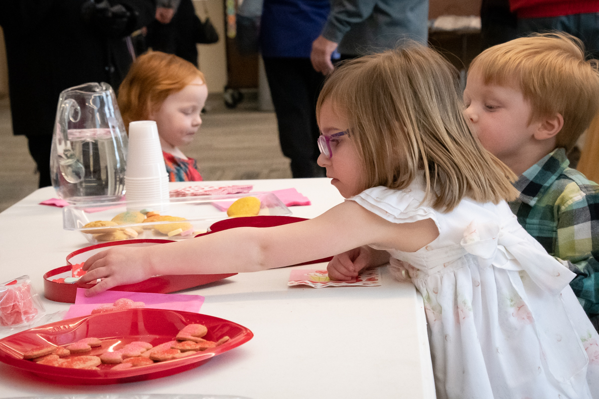 February 10, 2019:  When you see the cookie you want, you just must reach for it. Cookies in the Commons after Church.