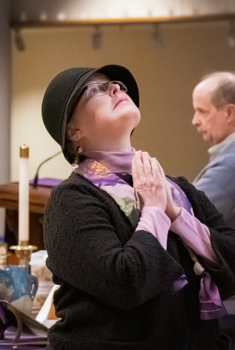 March 10, 2019:  Leslee O'Bradovich reflects reverently as husband Mike leads the opening of Worship during Lent.