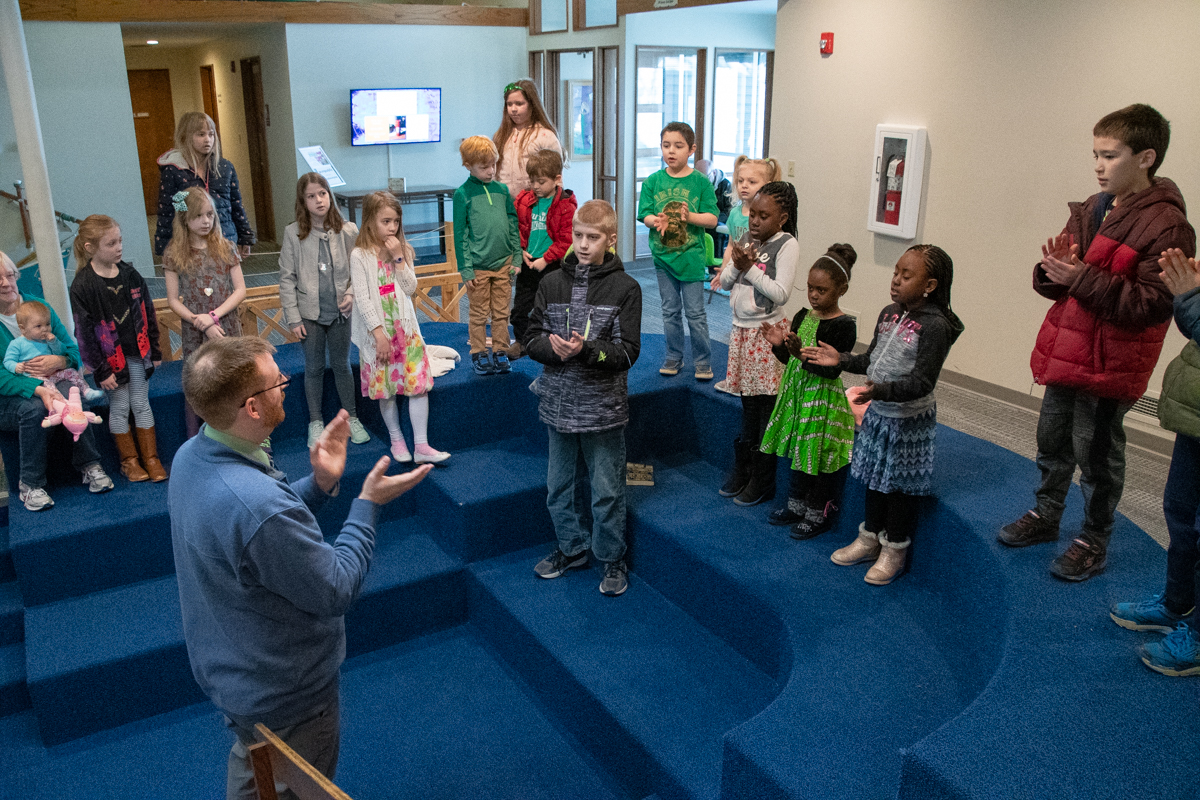 March 17, 2019:  Director of Music Chris Krampe leads the children in song each week at the start of the church school hour.