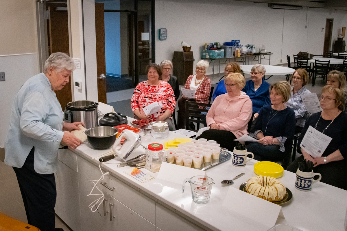 March 24, 2019:  Always popular, Winnie Pinch leads a cooking workshop at the annual Women's Retreat.