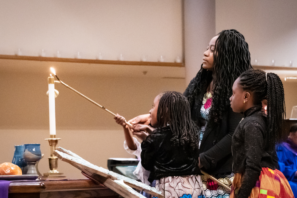 March 31, 2019:  During Lent, the Ahlijah family assists with the start of the Worship service by lighting the candles on the Communion table.