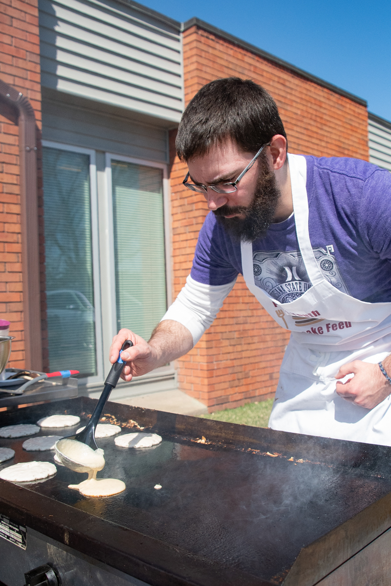 March 31, 2019:  Youth leader Tyler Foster makes pancakes for the fundraising breakfast to support the 2019 Youth Triennium trip.