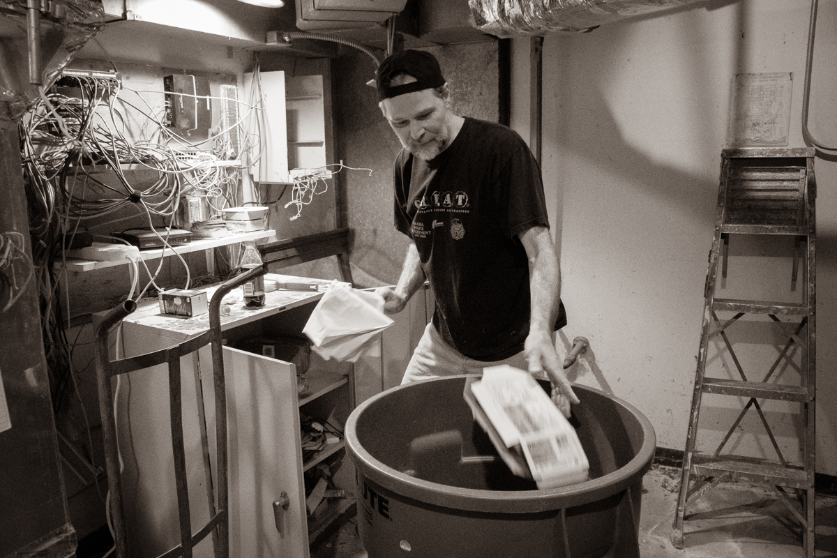 April 6, 2019:  Dylan Johnson tackles cleaning a furnace room that had been collecting junk during the recent building renovation project.