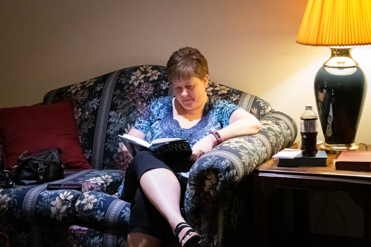April 7, 2019:  In the quiet solitude of the Ware Room, member Marcy Kastrick takes some time to read and reflect.