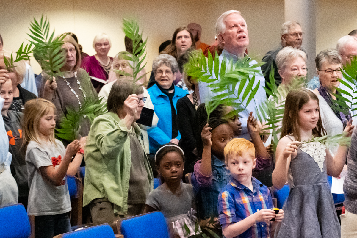 April 14, 2019:  Palm Sunday begins with the traditional procession of palms waving through the congregation.